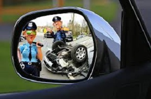 cartoon police in car mirror